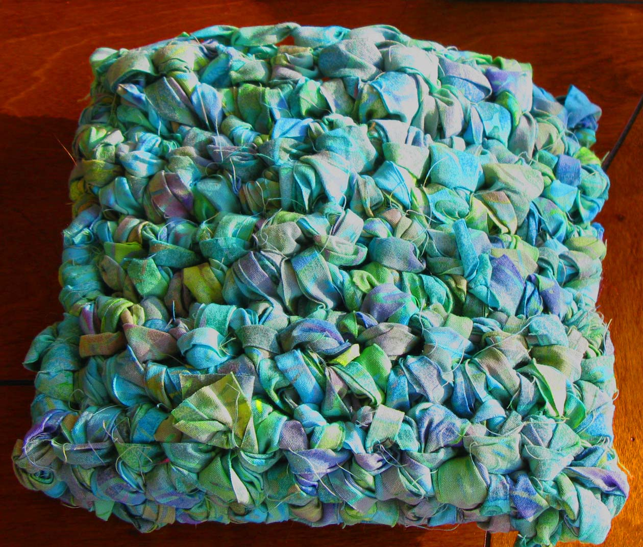 Crocheting Into Fabric : next quilted some fabric freehand style :
