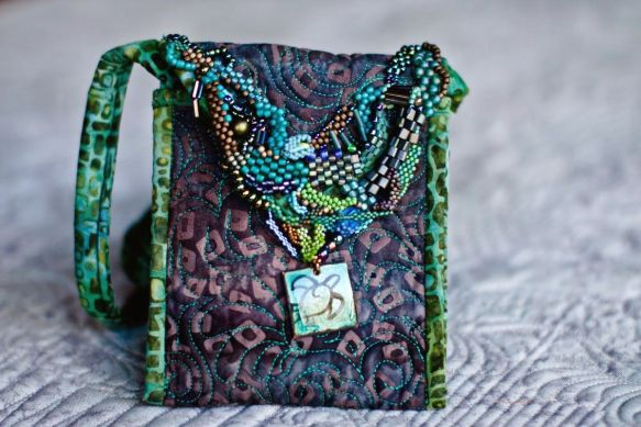 Freeform beaded purse by Carla Barrett
