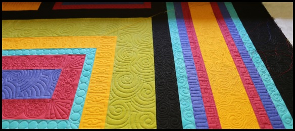 modern quilt by Carla Barrett using both freehand and digitized quilting